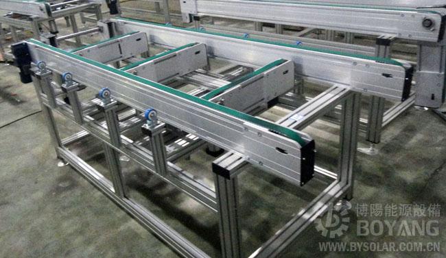 通过汽缸伸缩运动来实现纵向输送机构的升降移动.图片